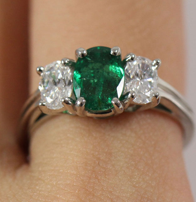 If you're feeling green this Saint Patrick's Day, gorgeous emerald and diamond three stone platinum ring.